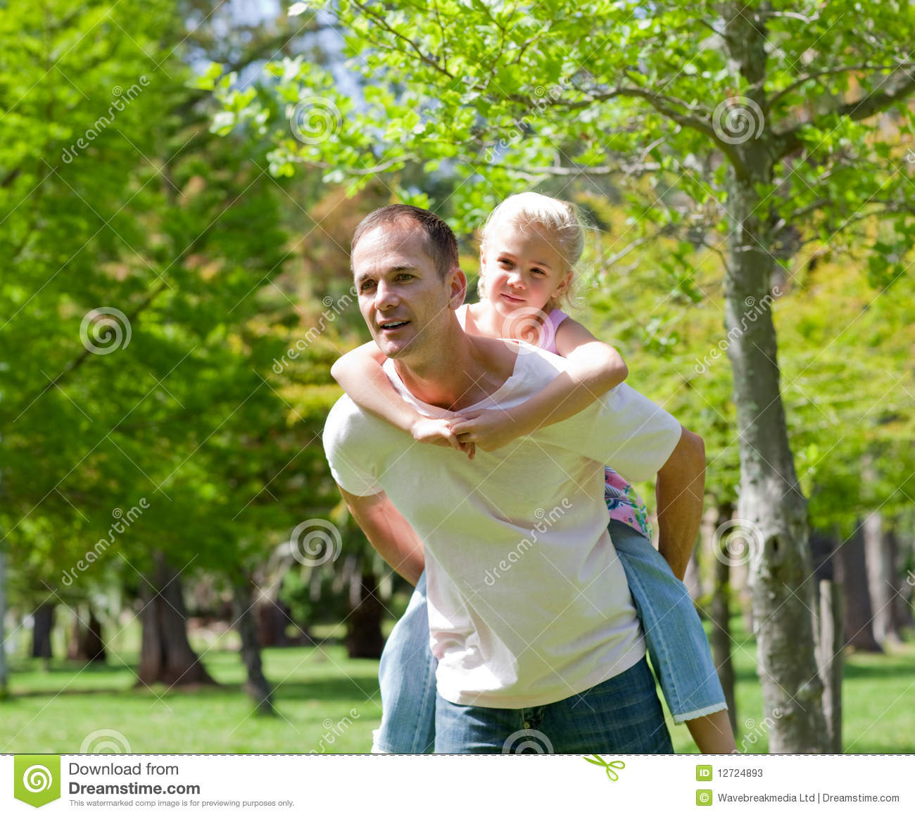 Father Giving His Daughter Piggy-back Ride Stock Image