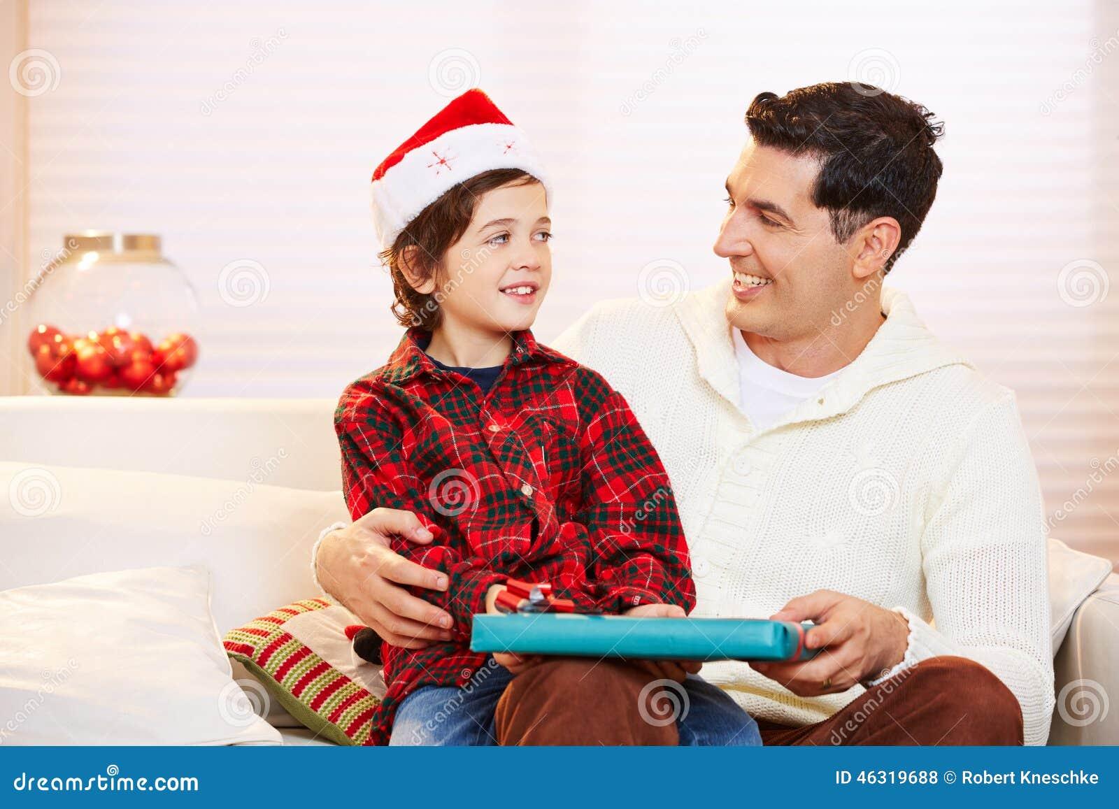 Father giving his son gift at christmas stock photo - Regalo padre navidad ...