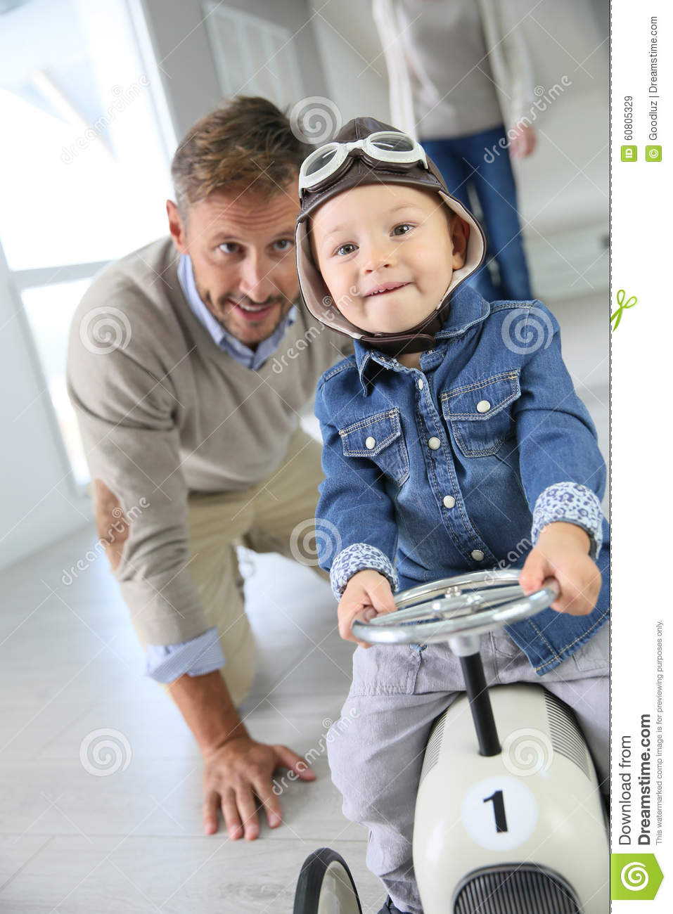Boy Toys For Dads : Father helping his son driving car toy stock image