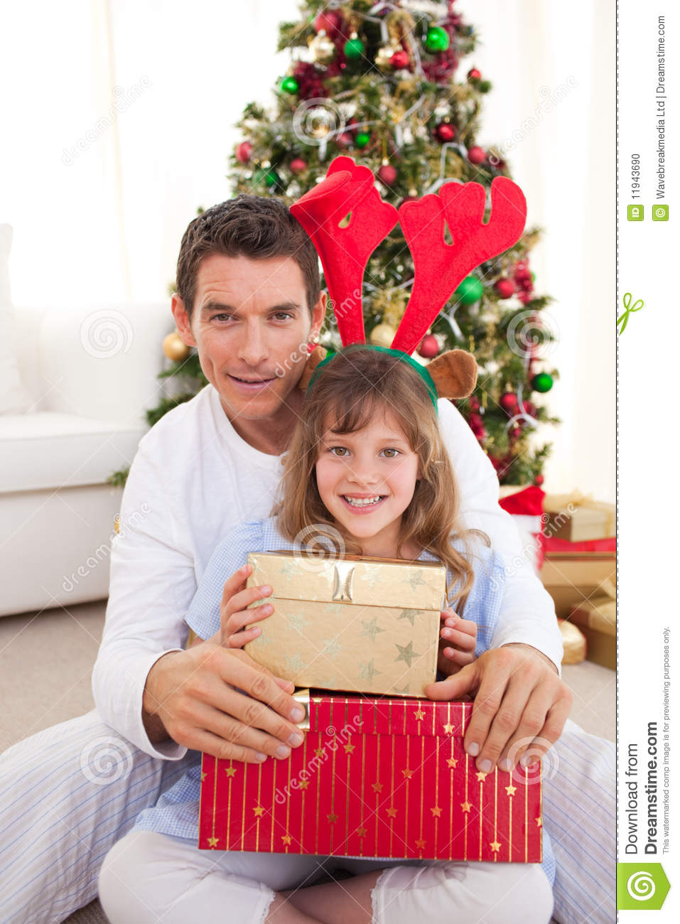 Father and his daughter opening christmas gifts stock for Christmas gifts for dad from daughter