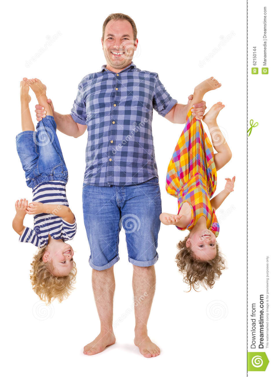 Father Holding His Smiling Children Upside Down Stock ...