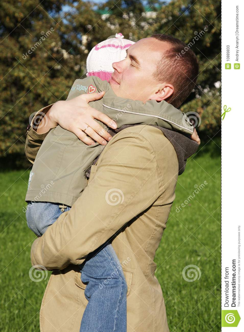 father hugs his little daughter
