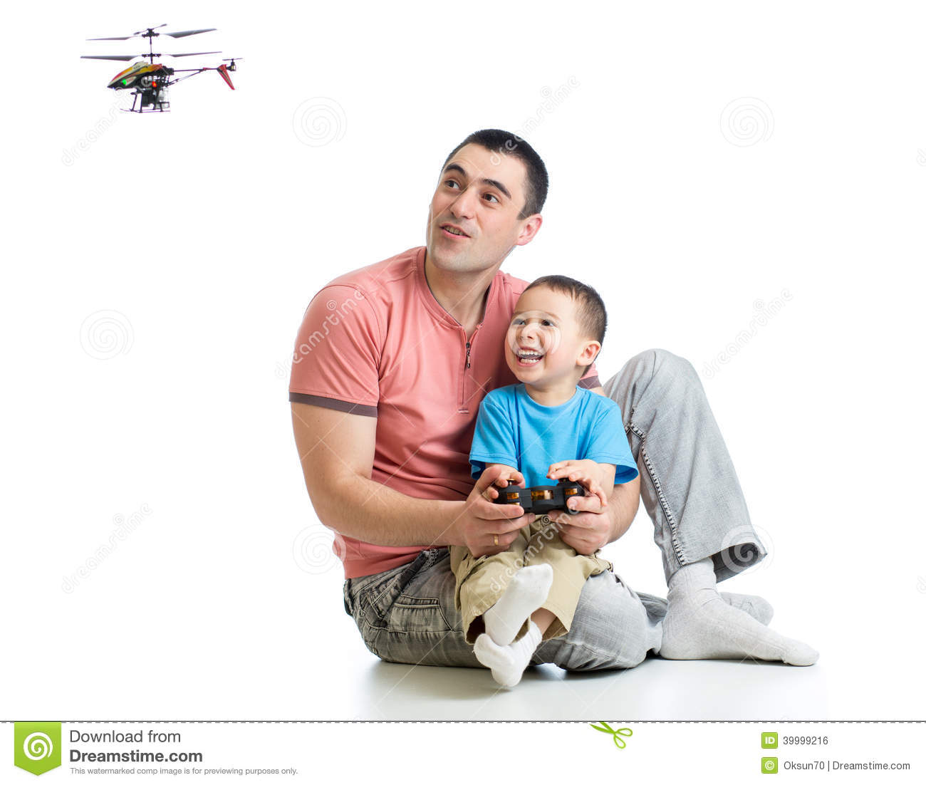 Father And Kid Playing With Rc Helicopter Toy Stock Photo