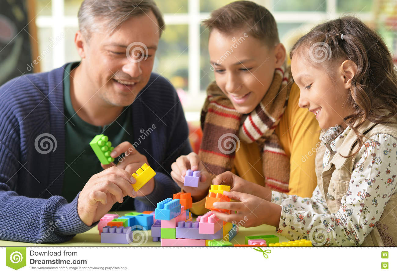 Father with kids play