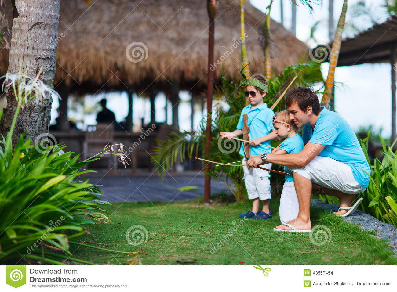 Father and kids playing outdoors