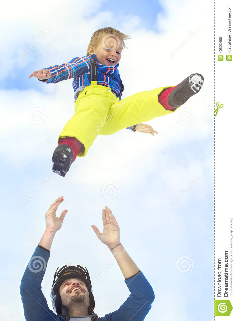 Father launching his son up in to the sky