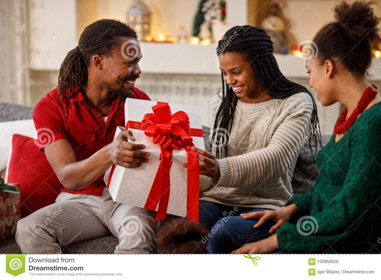 Father And Mother Giving Christmas Gift To Daughter Stock ...