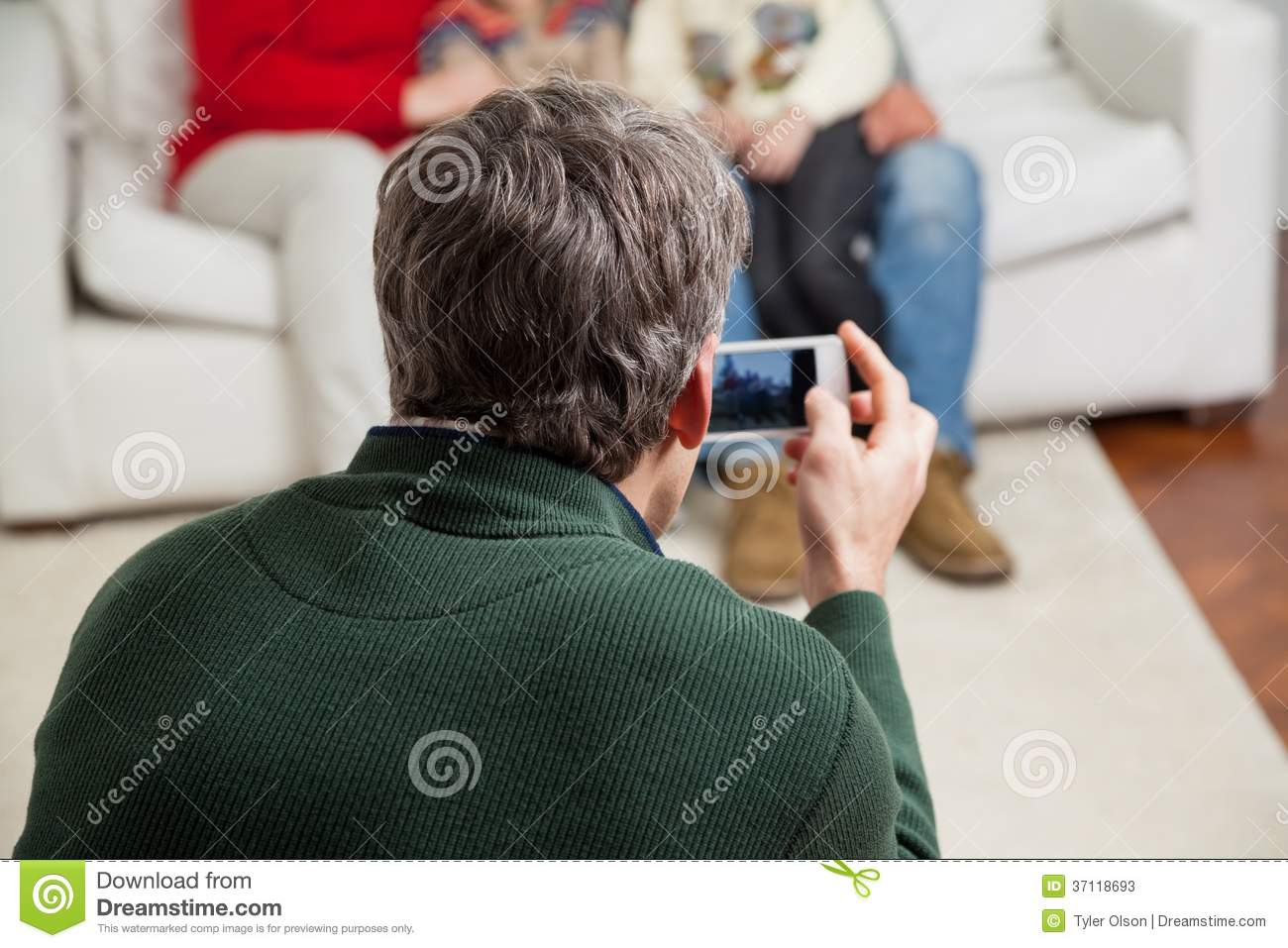 Father Photographing Family Through Smartphone Stock ...