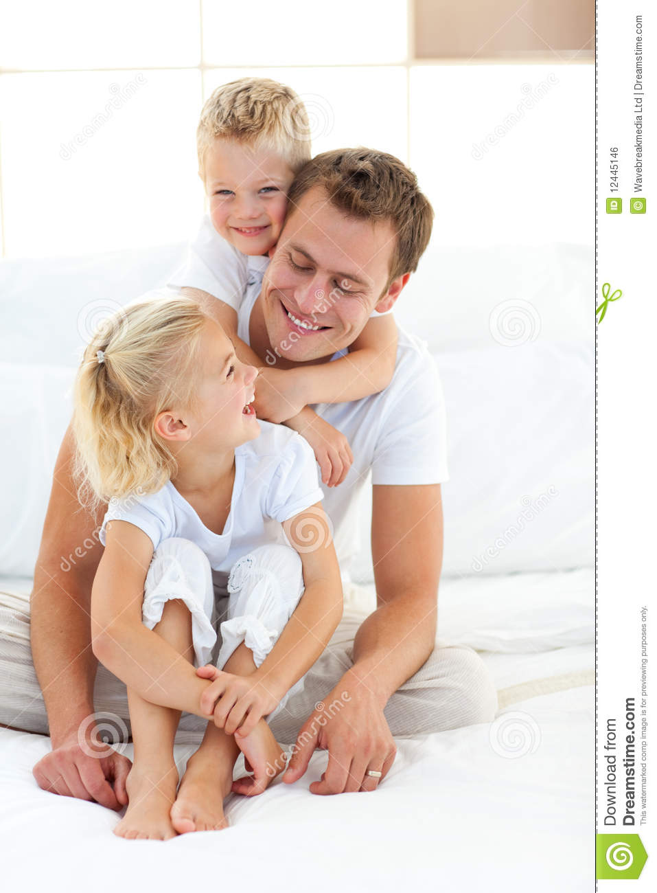 ... With His Children On A Bed Royalty Free Stock Image - Image: 12445146