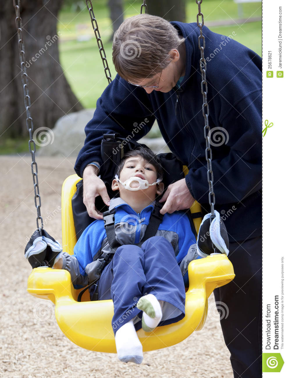 Download Father Pushing Disabled Son On Handicap Swing Stock Image - Image  of mixed, harness