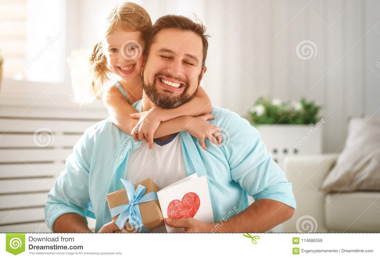 Father`s day. Happy family daughter hugging dad and laughs