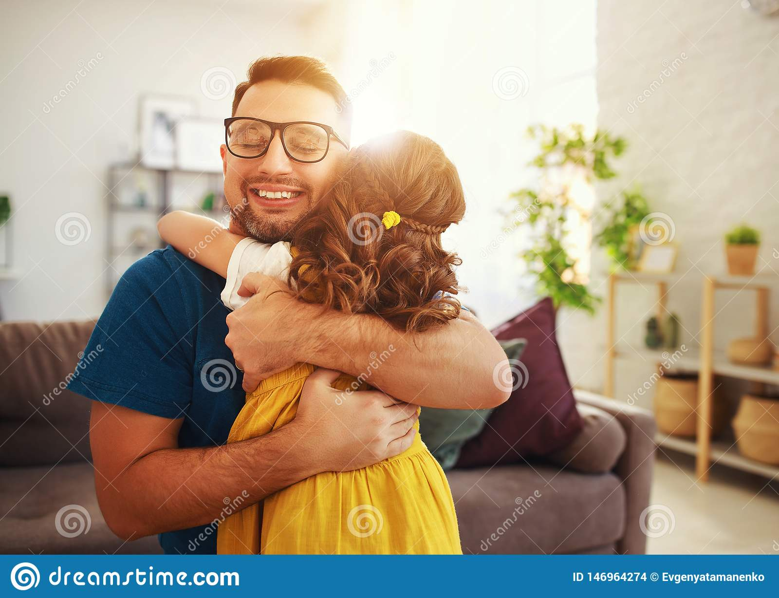 Father`s day. Happy family daughter hugs his dad