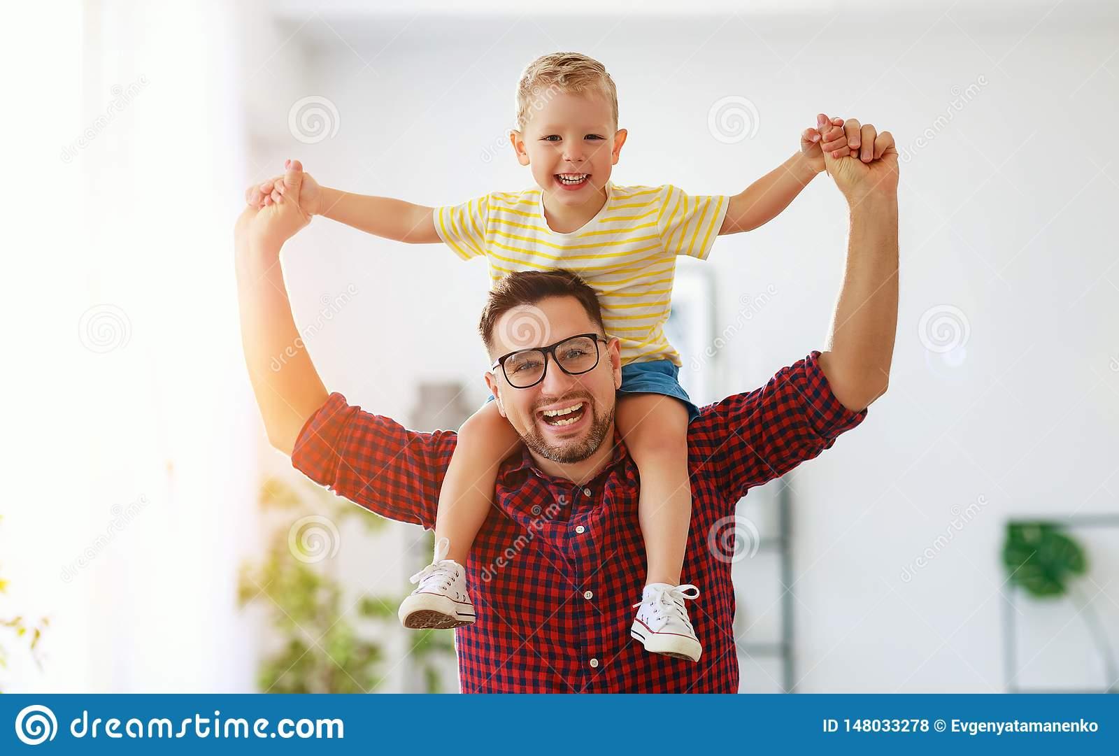 Father`s day. Happy family son hugs his dad