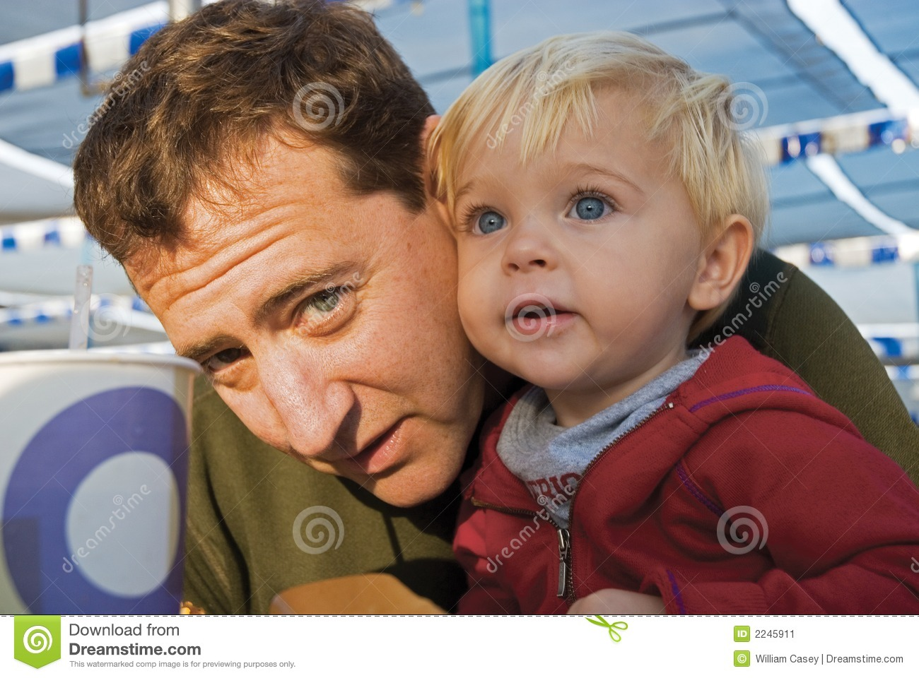 father and his son together at the beach petdcat dreamstime com