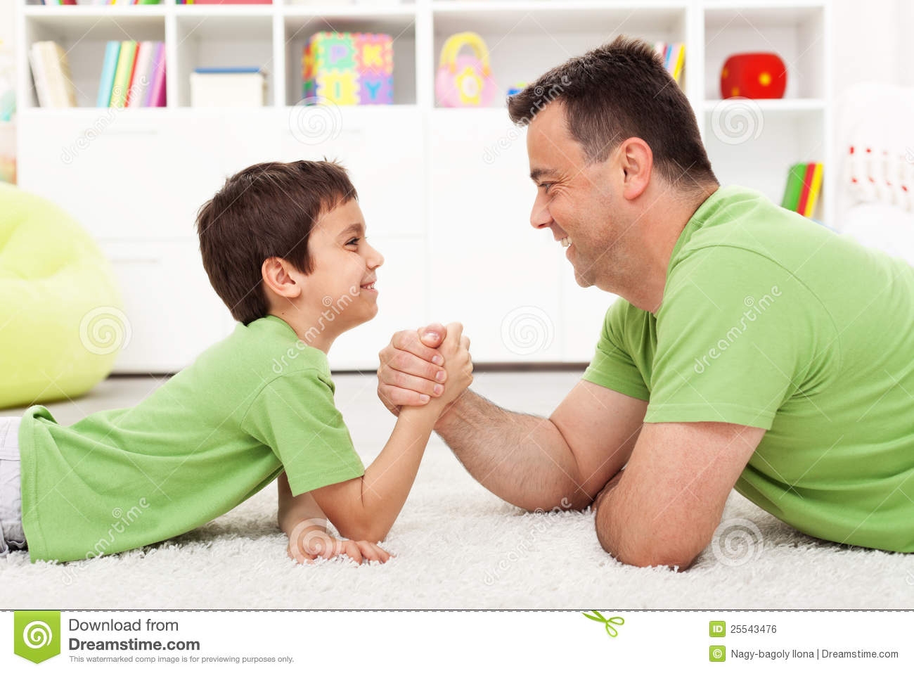 father and son arm wrestling royalty free stock image image 25543476. Black Bedroom Furniture Sets. Home Design Ideas
