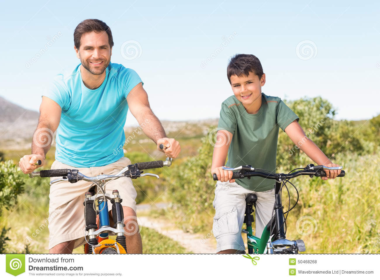 Father And Son On A Bike Ride Took A Break Royalty-Free ...