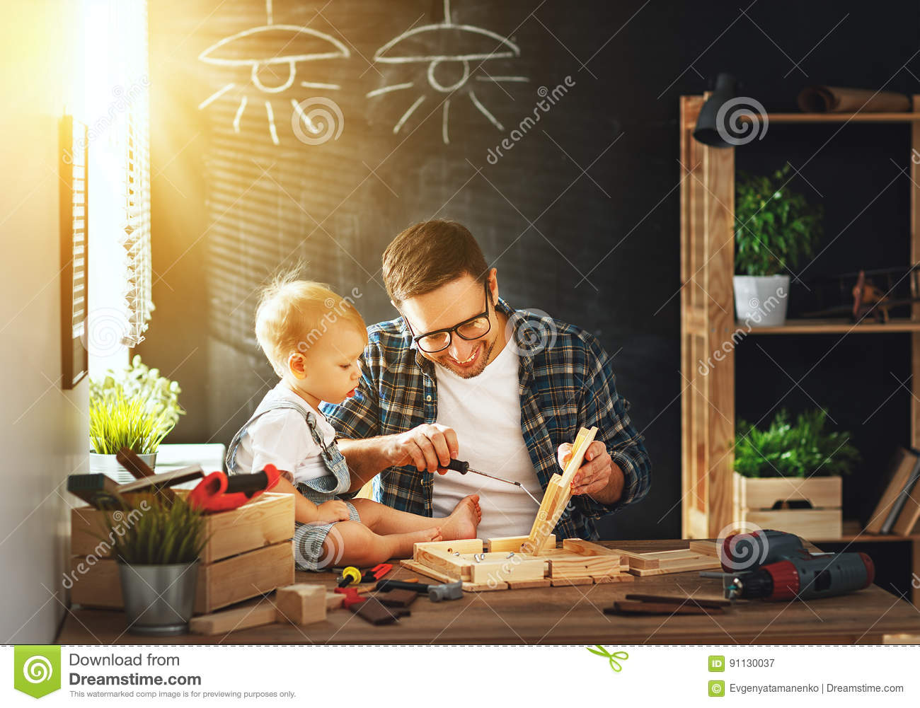 Father and son carved of wood in carpentry workshop