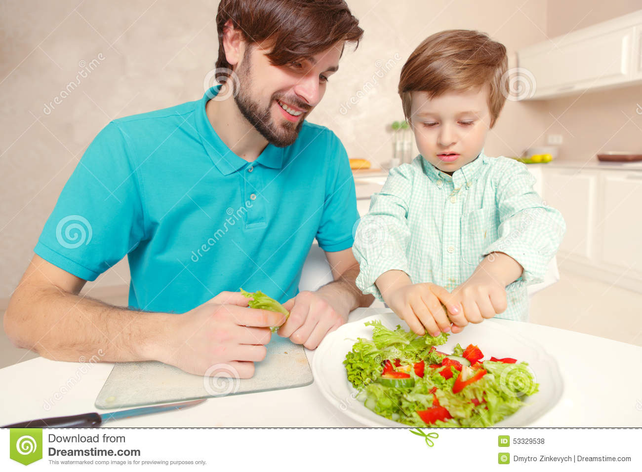 Father and son cook salad stock photo. Image of child - 53329538