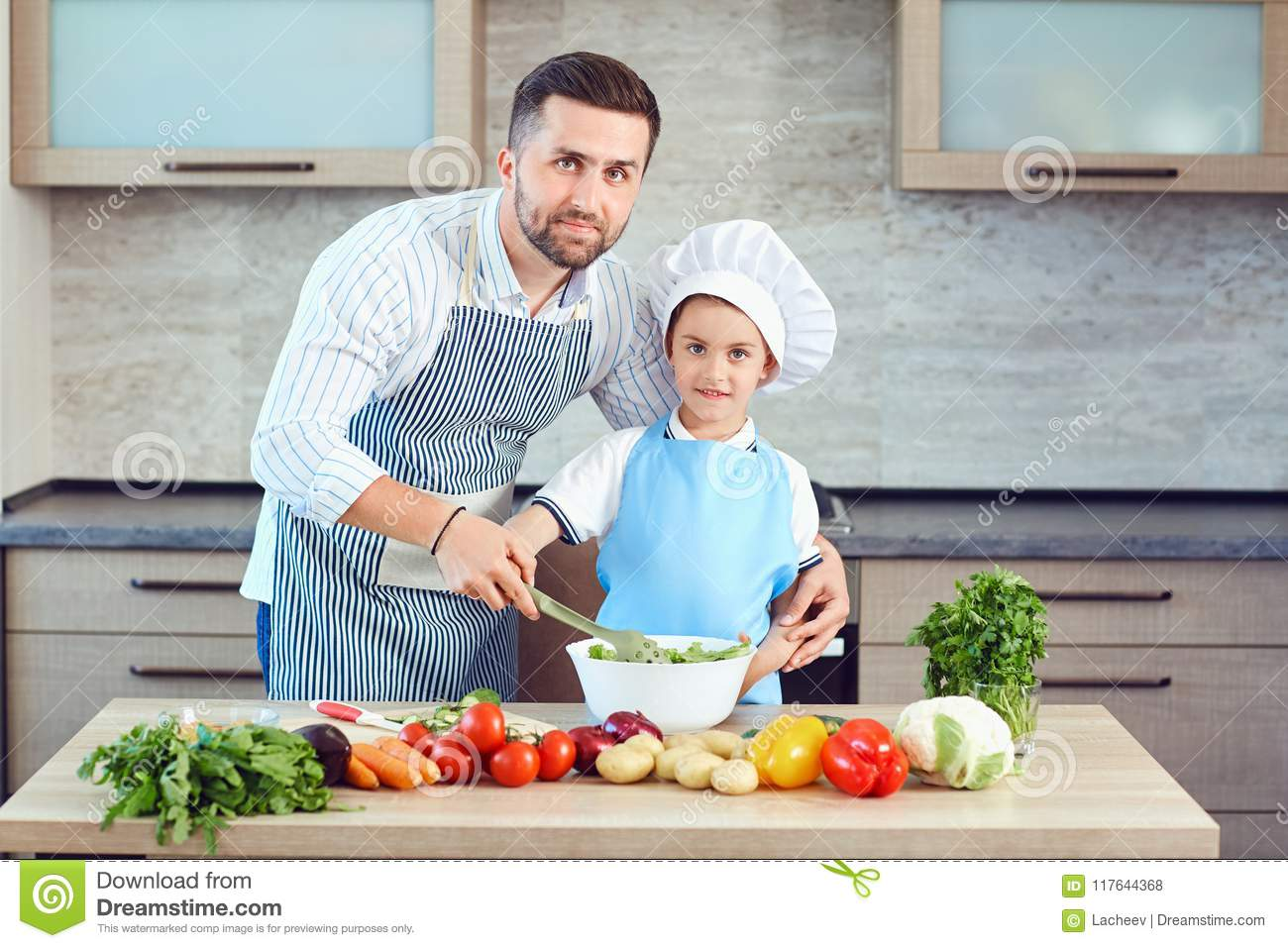 Father And Son Are Cooking In The Kitchen Stock Photo - Image of ...