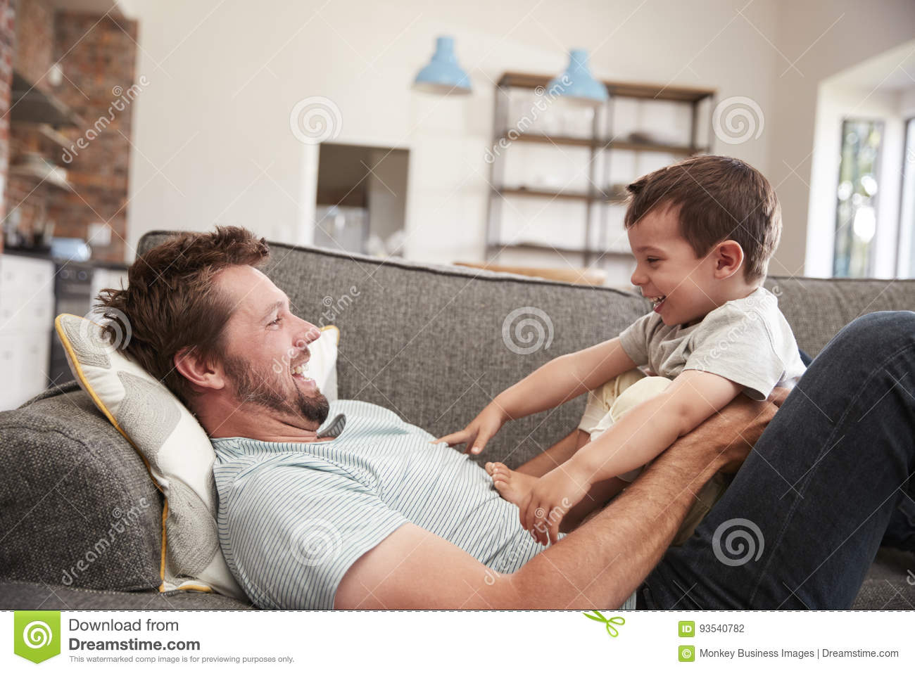 Bon Download Father And Son Cuddling On Sofa Together Stock Photo   Image Of  Cuddling, Estate