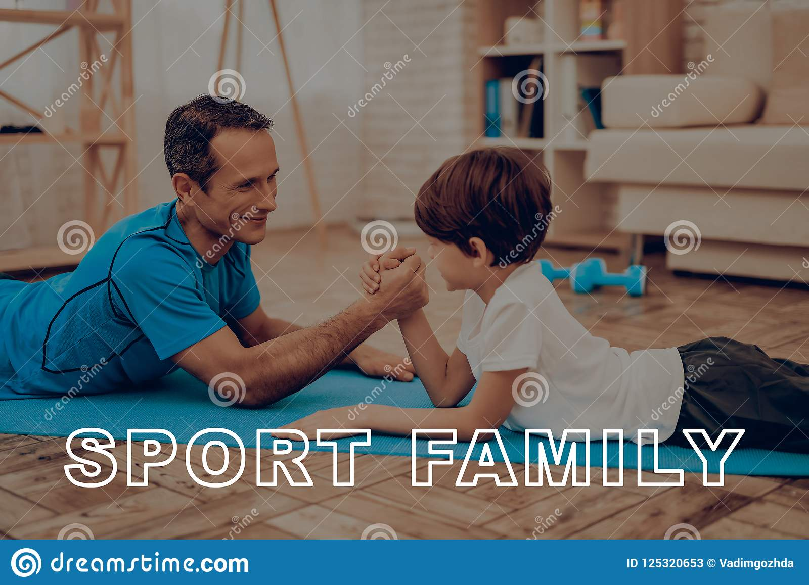 Father And Son Are Doing A Gym. Sport Family.