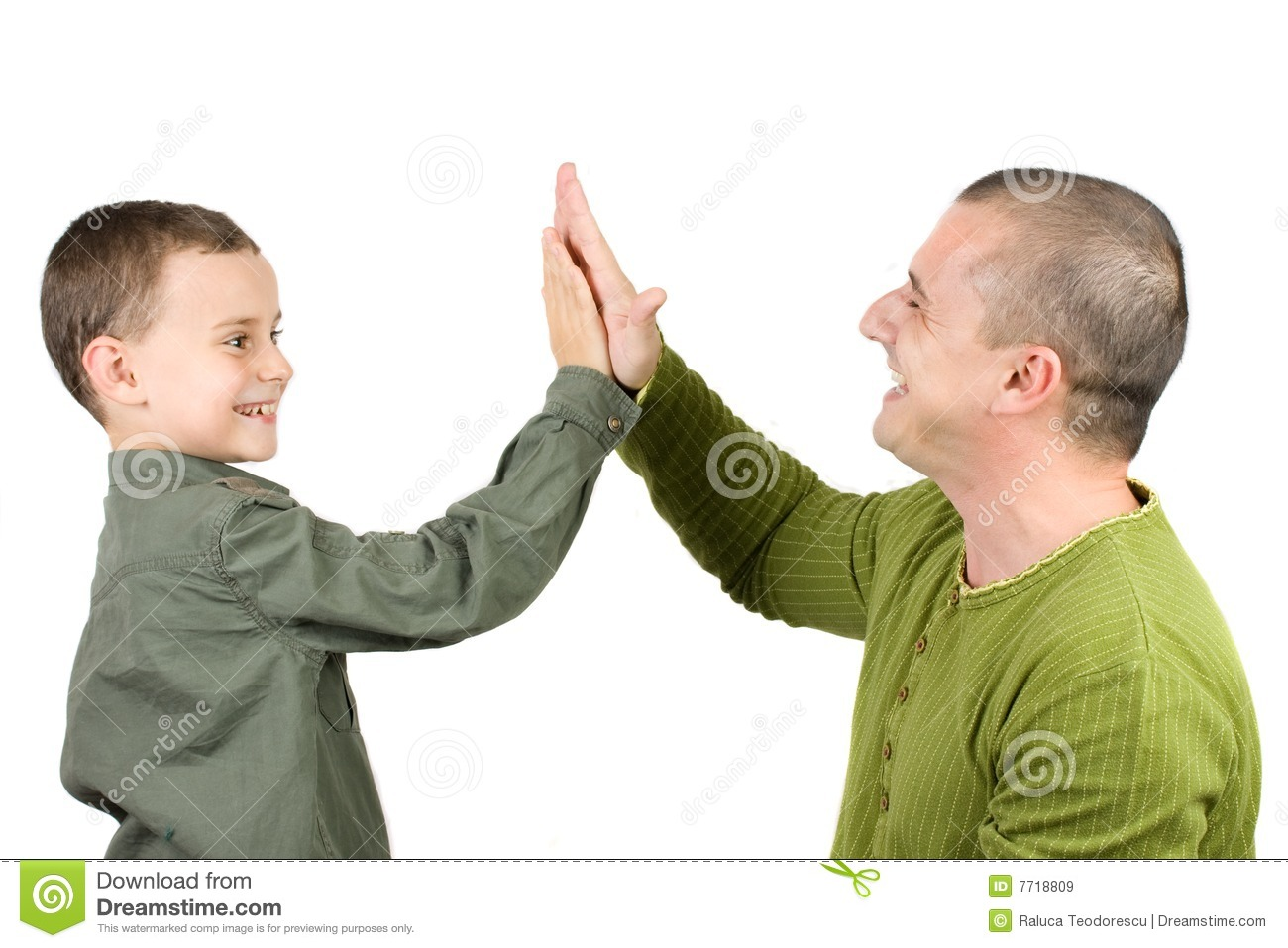 father and son doing a high five stock image image 7718809. Black Bedroom Furniture Sets. Home Design Ideas
