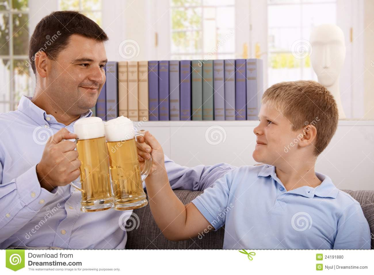 Father And Son Drinking Beer Smiling Stock Photo Image