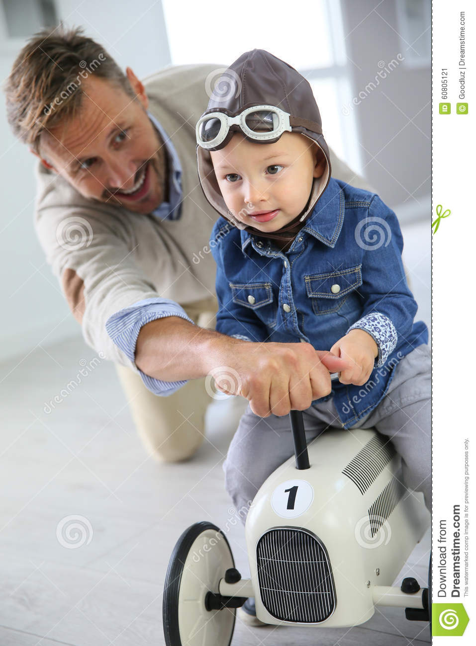 Boy Toys For Dads : Father with son driving retro car toy stock image