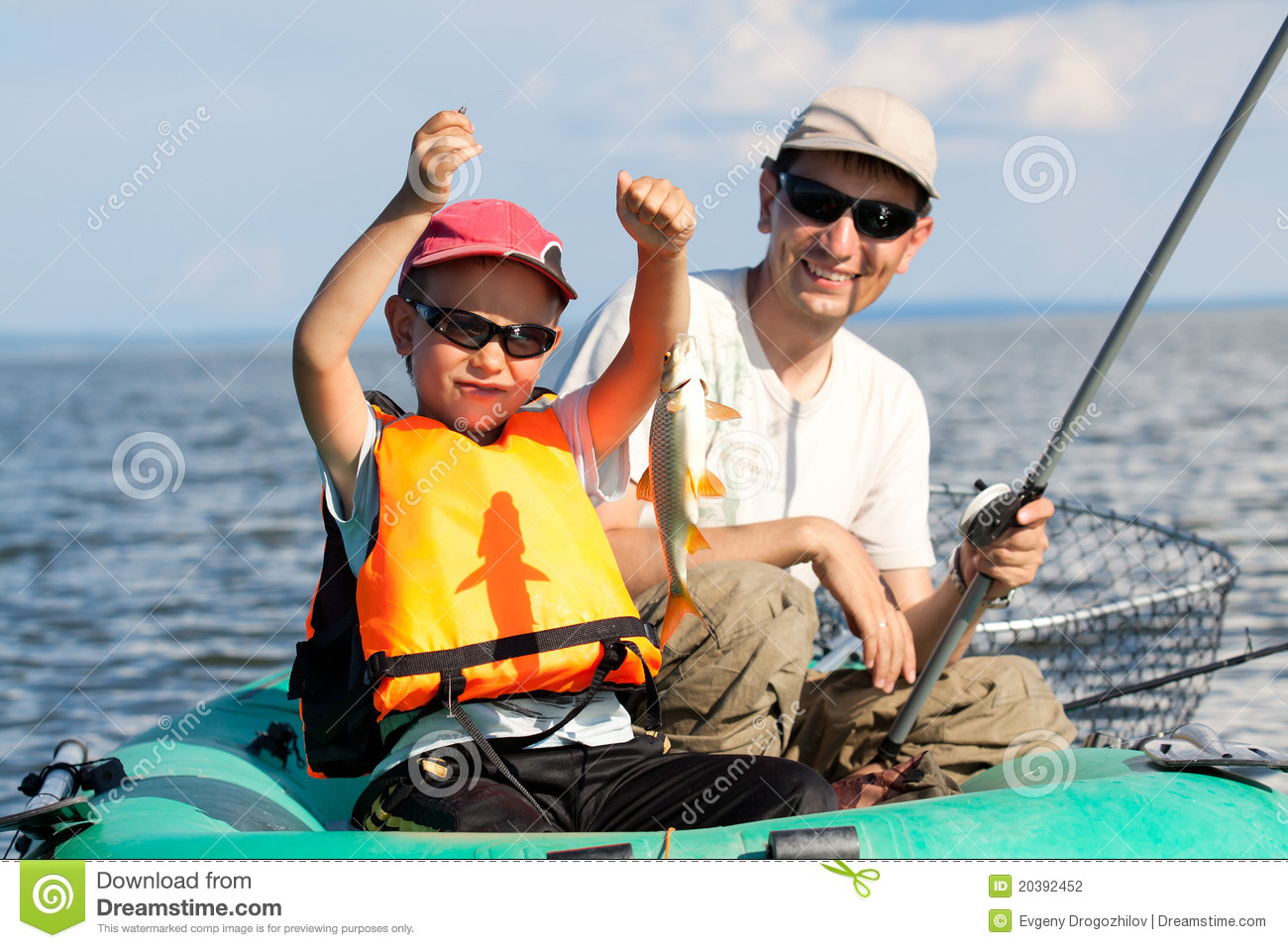 Father and son fish in a boat stock photography image for Father son fishing