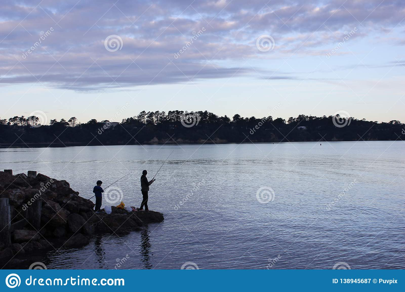 Father and son fishing on a lake