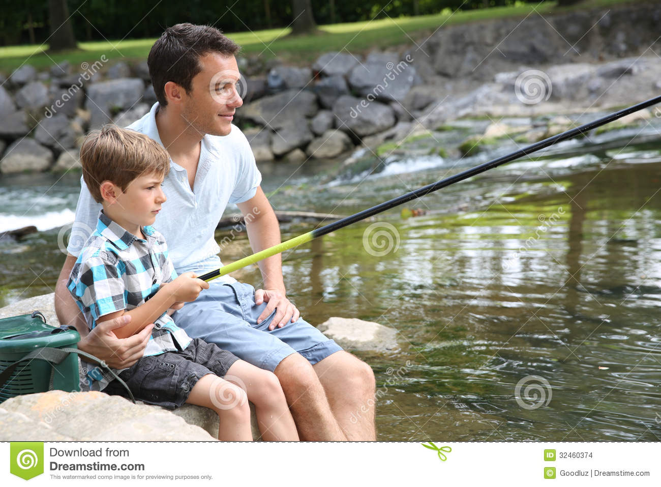 Father And Son Fishing In The River Stock Photo ...