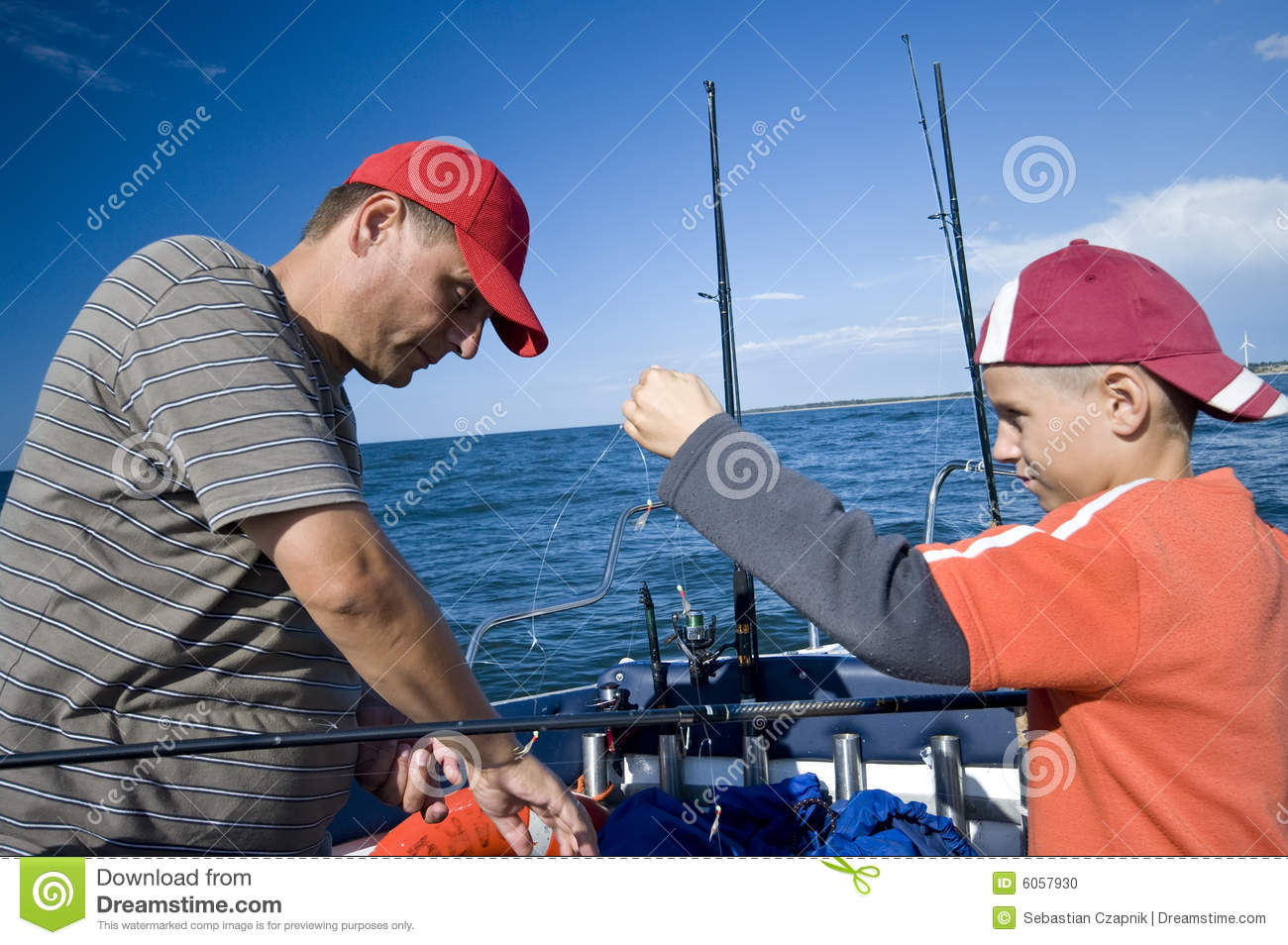 Father and son fishing at sea