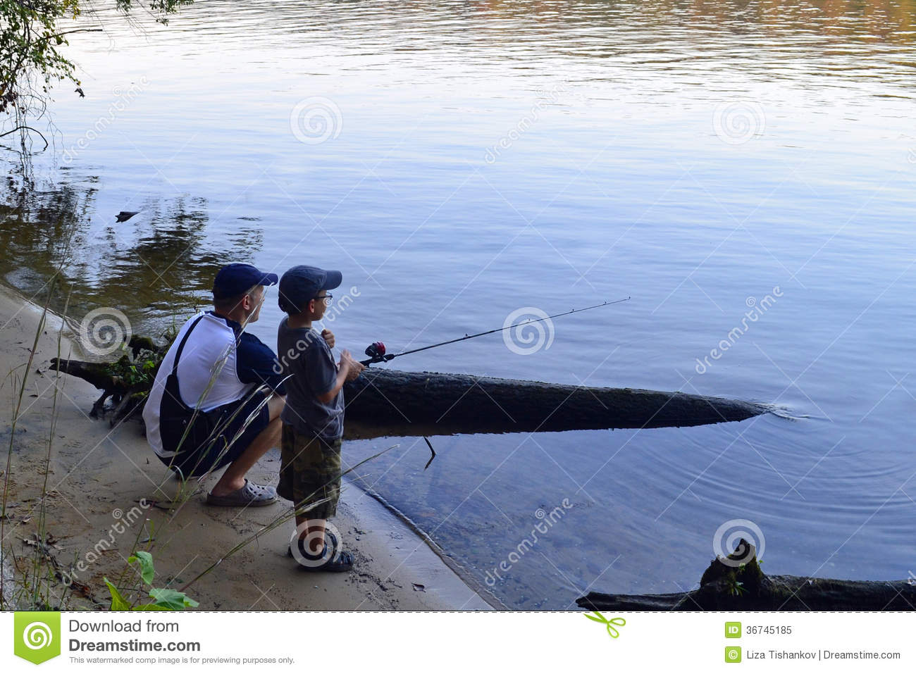 Father and son fishing in the river stock photo for Father son fishing