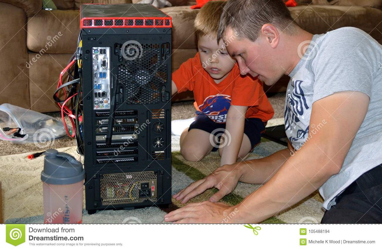 Father and Son Fixing Computer
