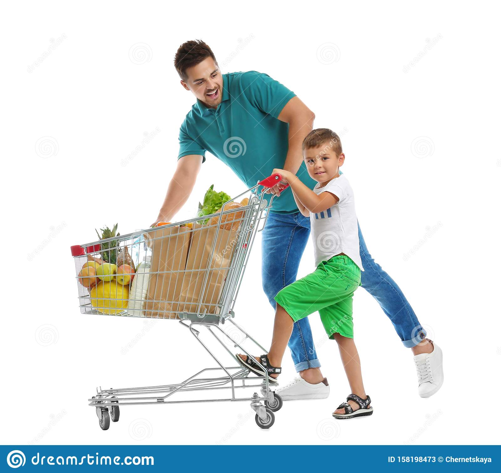 Father and son with full shopping cart on background