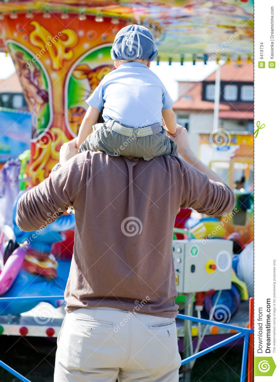 Father and son fun merry go round