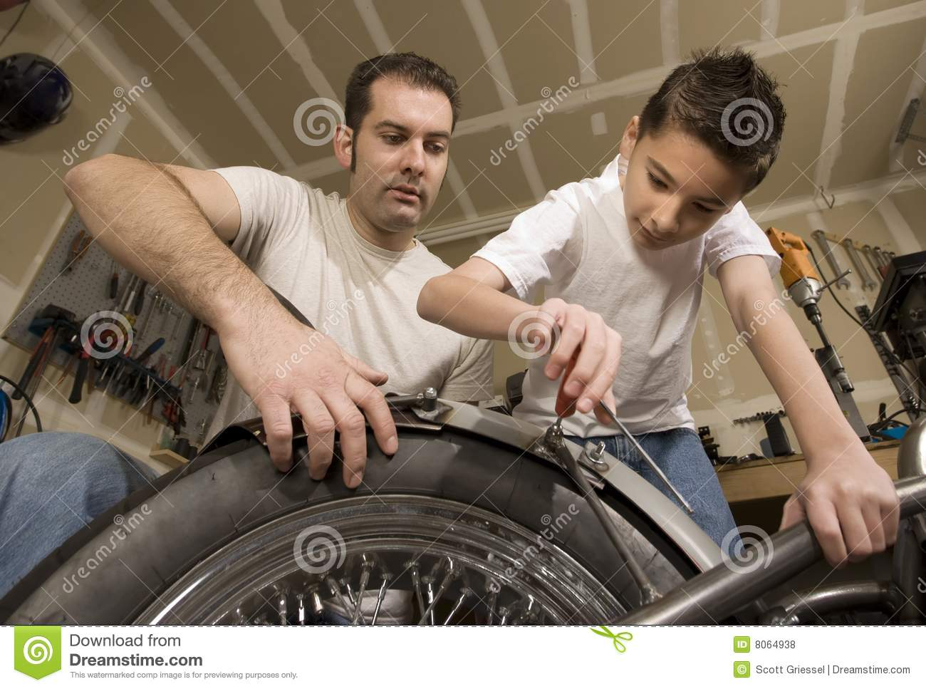 Father And Son In Garage Royalty Free Stock Photos Image