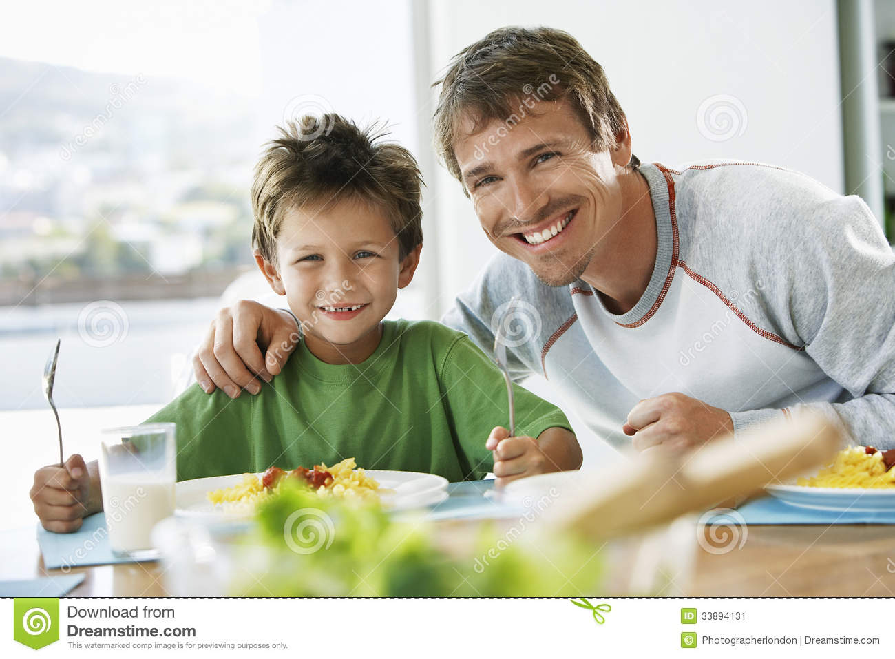 Father And Son Having Breakfast At Table Stock Image  : father son having breakfast table portrait happy together dining 33894131 from www.dreamstime.com size 1300 x 957 jpeg 126kB