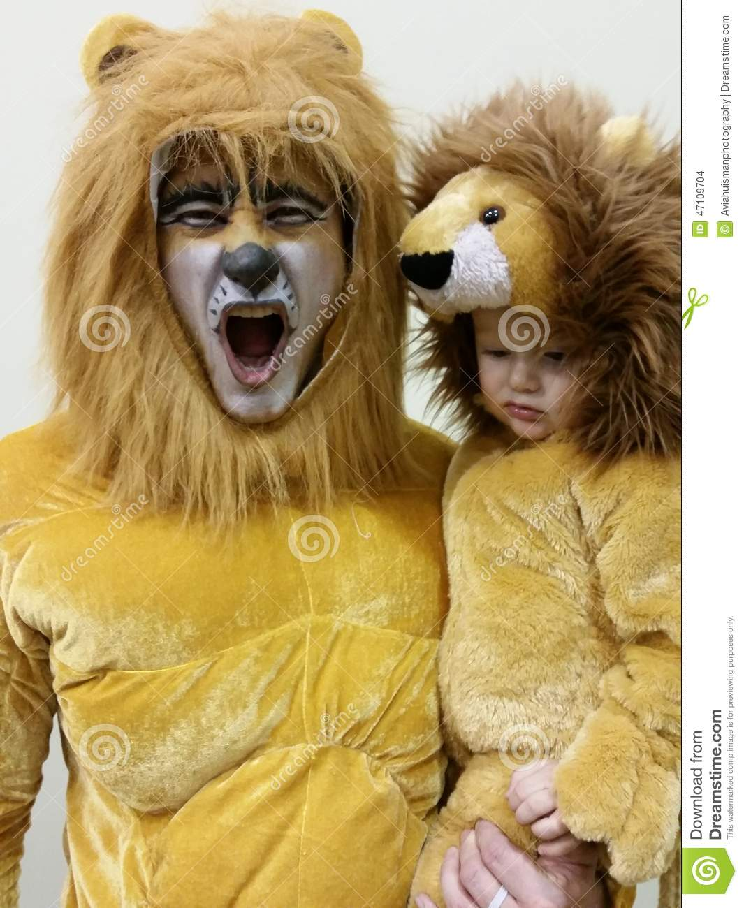 Father and Son in Lion Costumes