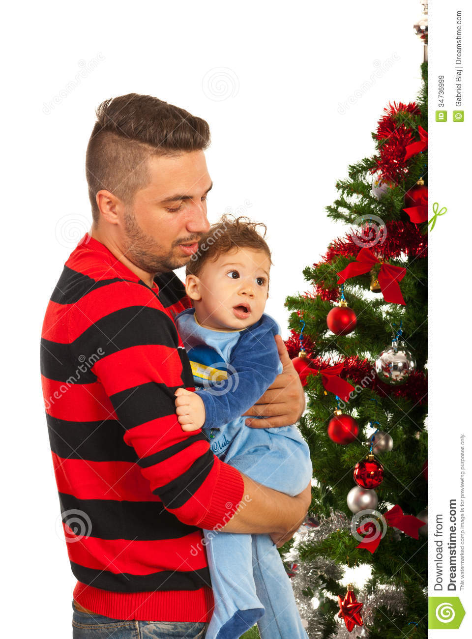 Father and son near Christmas tree