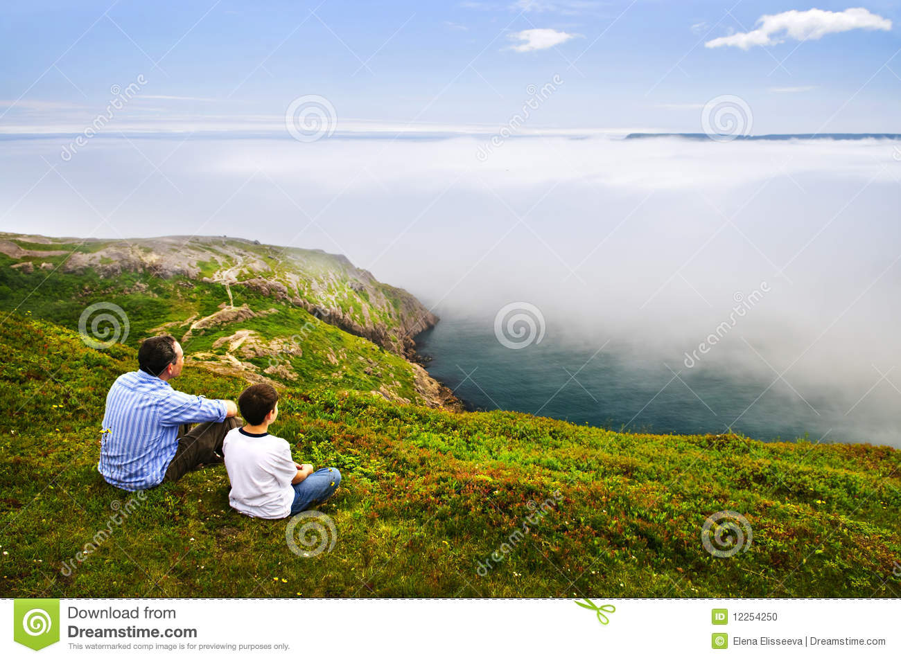 Father and son at ocean coast