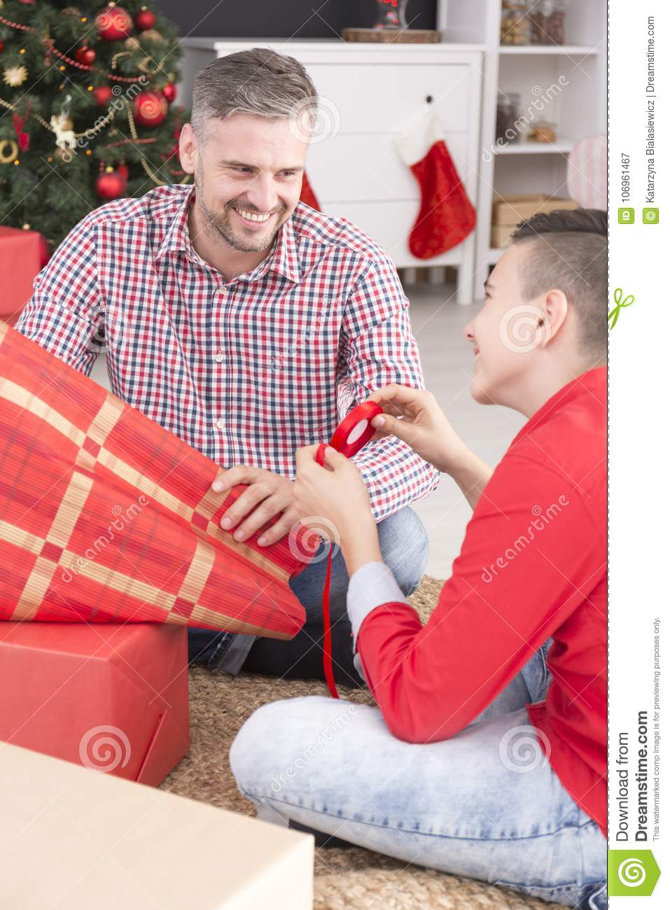 Father And Son Packing Gifts Stock Image - Image of merry