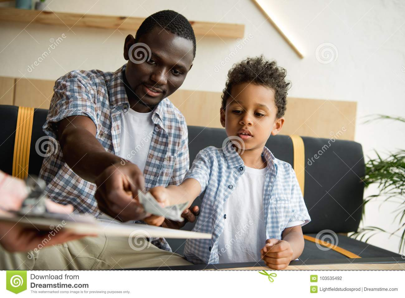 Download Father and son paying bill stock photo. Image of finance - 103535492