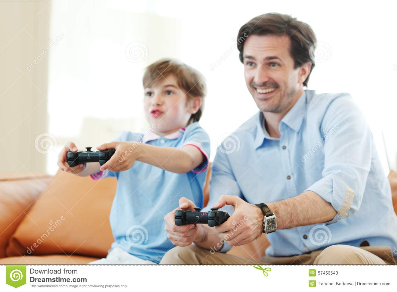 father and son play video game stock photo image 57453540. Black Bedroom Furniture Sets. Home Design Ideas
