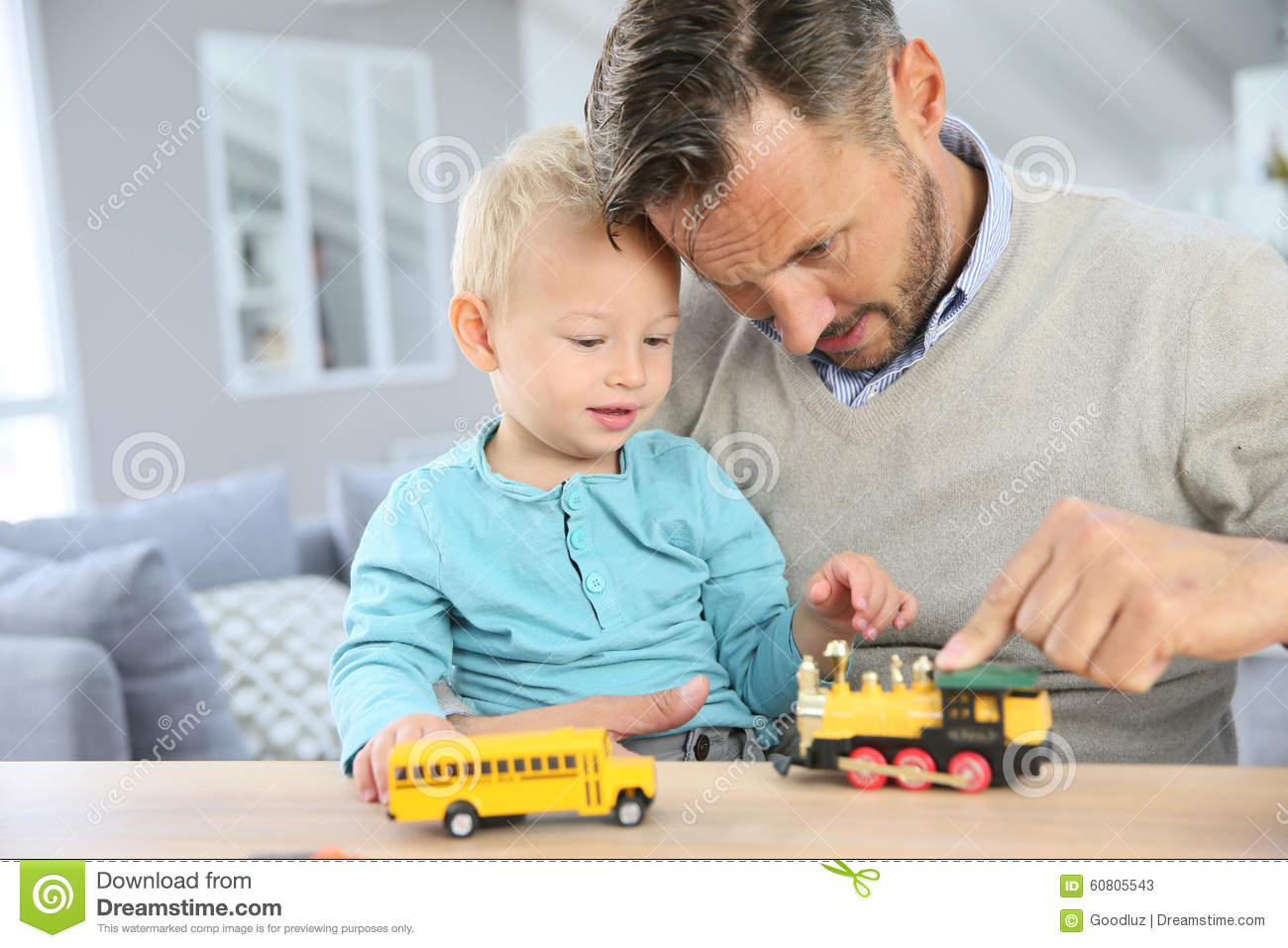 Toys For Dads : Father and son playing with car toys stock photo image