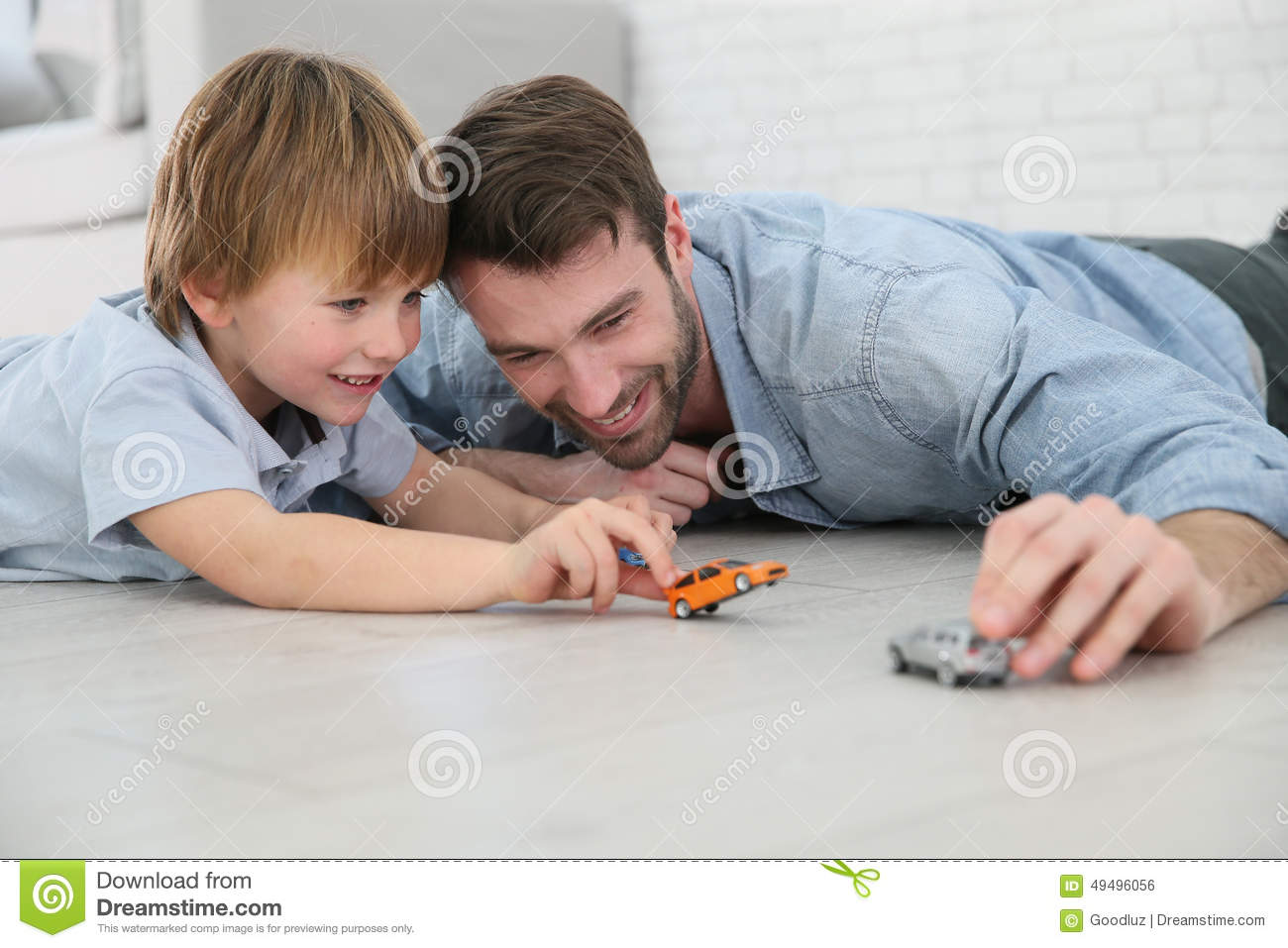 Boy Toys For Dads : Father and son playing with car toys stock photo image