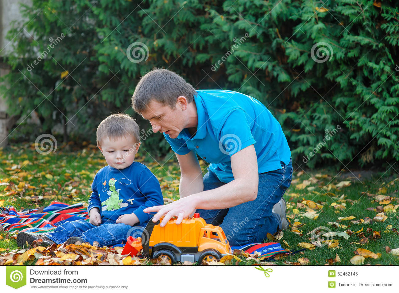 751cce8ae Father And Son Playing In The Park Toy Car In A Park On The Gras ...
