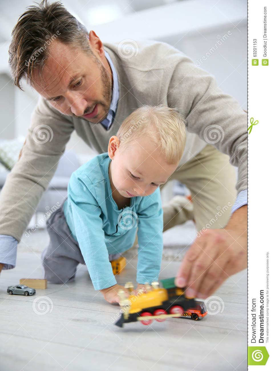 Boy Toys For Dads : Father and son playing with toy cars on the floor stock