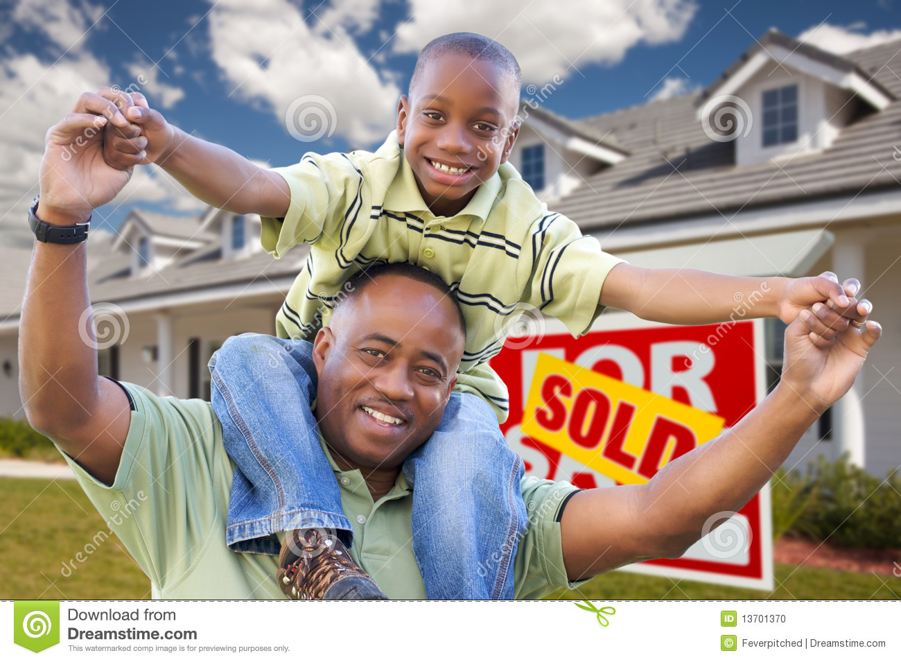 Father and Son with Real Estate Sign and Home