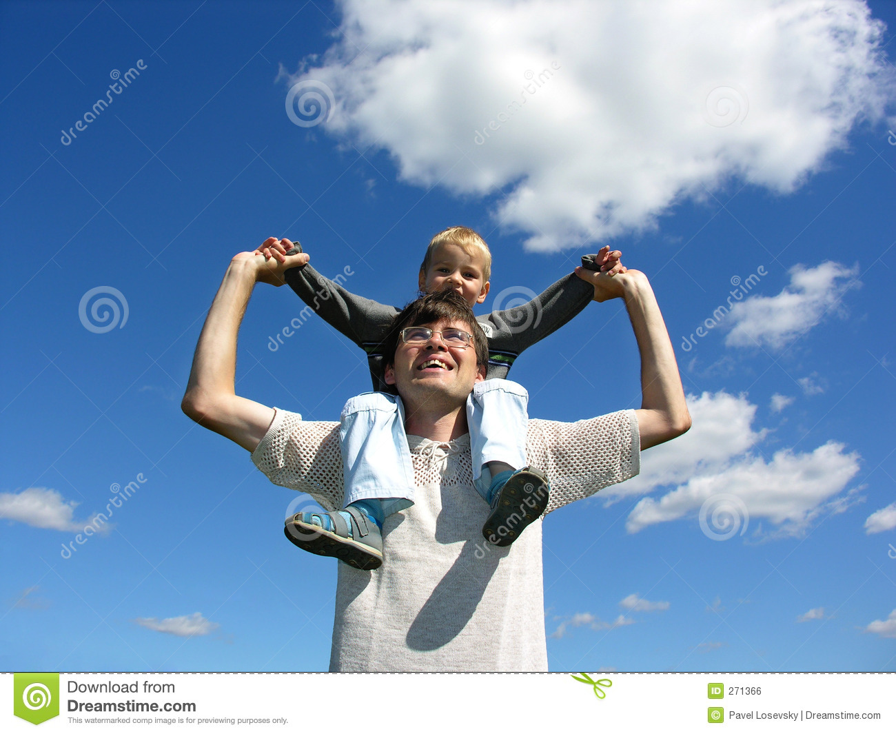 Father with son on shoulders sunny day 2